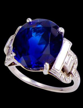 An art deco sapphire and diamond ring, Grogan, circa 1925 set with an oval-cut sapphire, weighing 9.94 carats, with baguette and single-cut diamond geometric shoulders; mounted in platinum; size 5 3/4