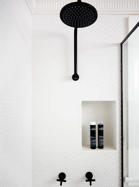 Tiling wall niches in the same wall tile gives a minimalist look and won't date. Off centre the niche for a design feature.