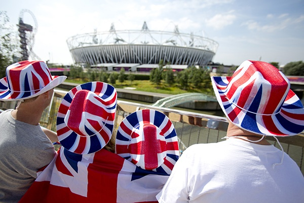 Spectators wearing hats in British national colours look at the Olympic Stadium in the Olympic Park during the London 2012 Olympic Games. (Photo by Neil Hall/Reuters)