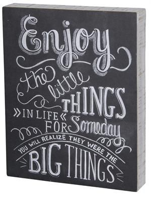 The Chalkboard Sign-Enjoy the Little Things in life is an inspiring message perfect for any home. Hang in the kitchen or by the front door as a friendly reminder to the family before they head out for the day. Designed to look just like a chalkboard, this wooden wall art features a box frame design with white-wash sides.