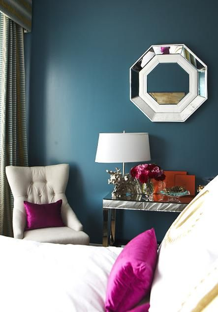 Pops of magenta add bold color to a glam interior.