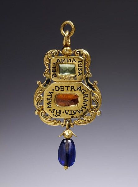 Amulet pendant, made in England, 1540-60. The settings of the stones on this pendant are open at the back allowing direct contact with the wearer's skin. According to medieval and Renaissance beliefs, the magical properties of the stones could thus benefit and protect the wearer. The power of the amulet is heightened by an inscription to ward off epilepsy.