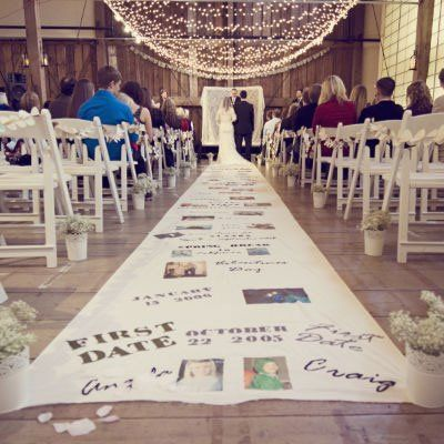 This DIY aisle runner tells the couple's story, from the first date to the proposal!