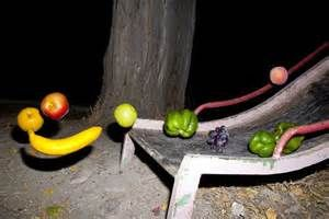 I love high contrast photos of fruit floating threateningly in the night.