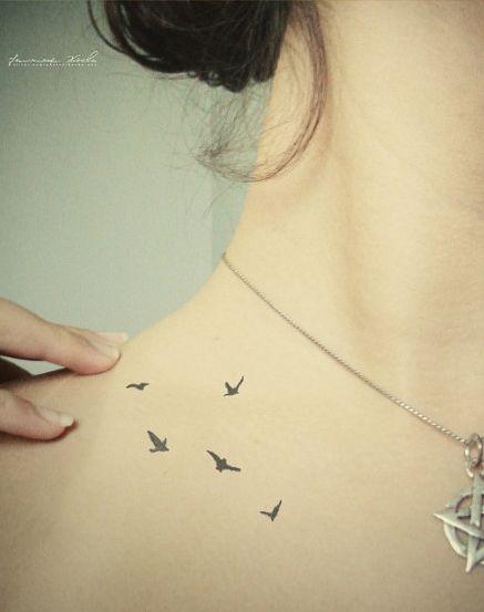bird tattoo on collar bone