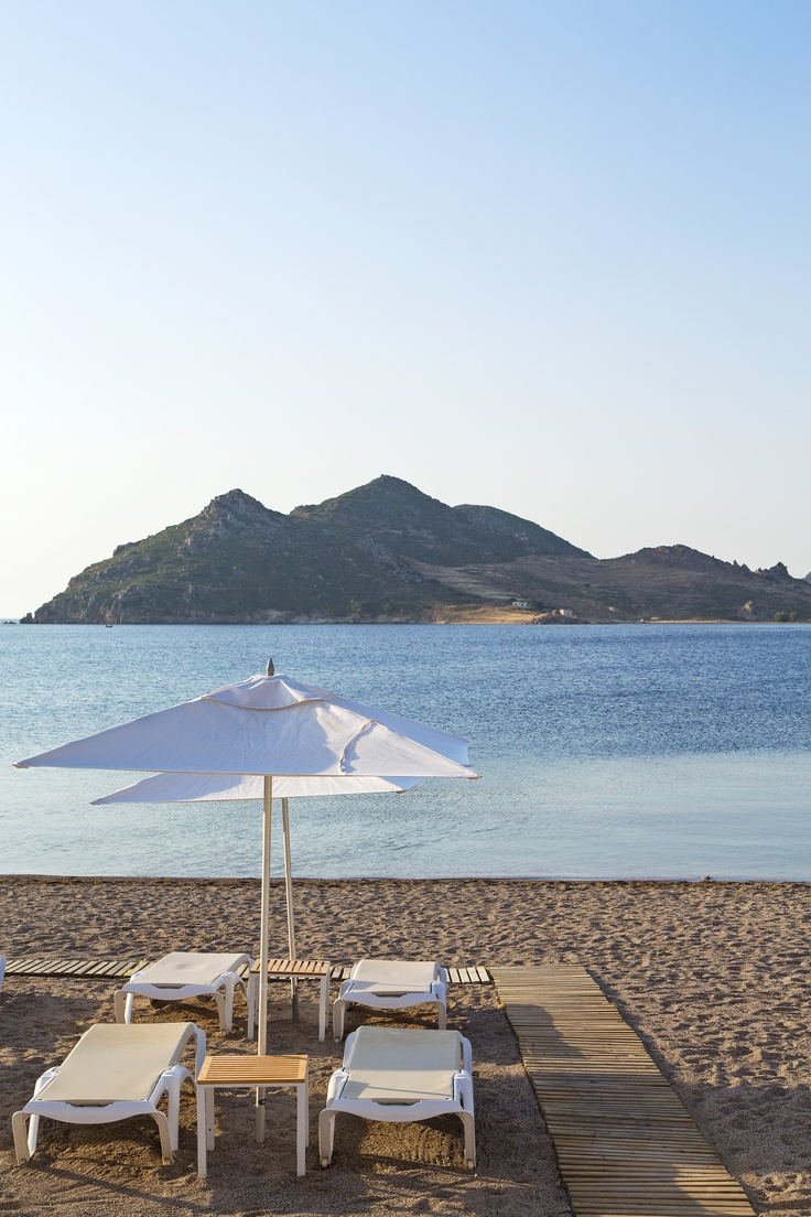 The Greek sun will capture your heart and the feeling of absolute luxury will calm your spirit at Patmos Aktis Suites & Spa beach...