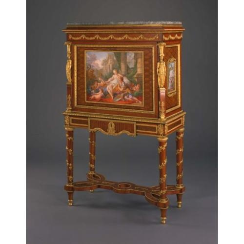 This secrétaire by Bernard Molitor was initially made in the 1780s without the three porcelain plaques, which were added during the 19th century. The center plaque, painted by Charles Nicolas Dodin, were originally the centerpiece of a table top given by Louis XVI to his brother-in-law, the Duke of Saxe-Teschen in 1786.The two side plaques were originally mounted as doors in a cabinet circa 1825. It's estimated that the alternations to the secrétaire took place in the late 1800s.