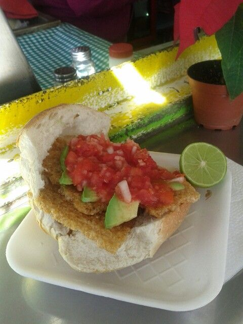 Guacamaya Torta Sandwich - crispy pork skin, avocado and pico de gallo salsa