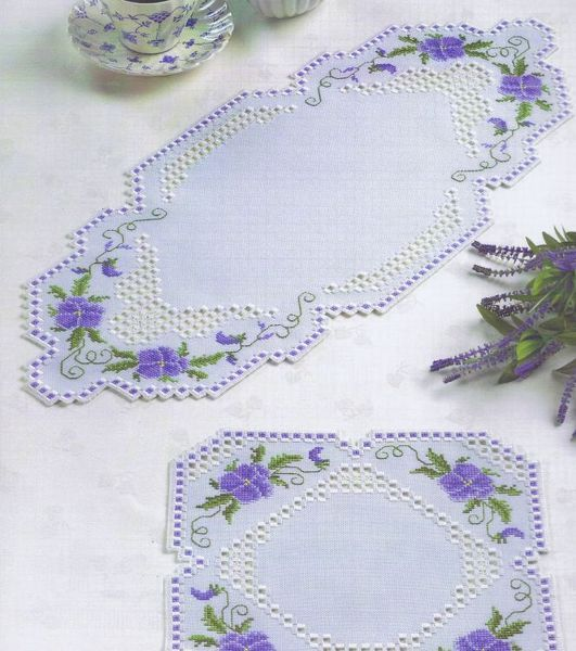 A mixture of traditional white hardanger and cross stitch makes a very attractive mats for tables or dressing table.