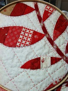 "Beautiful hand quilting from Laurie Simpson from Minick and Simpson featured on Moda Fabrics United Notions The Cutting Table!  ""While Polly is best known for her hooked rug designs, Laurie is the quilter. She pieces all her quilts on her Singer Featherweight and prefers to hand quilt them whenever possible. Lately she's been especially drawn to big stitch quilting, using 12-weight #Aurifil thread.""  http://modafabrics.blogspot.com/2013/10/minnick-and-simpson-midwinter-reds.html"
