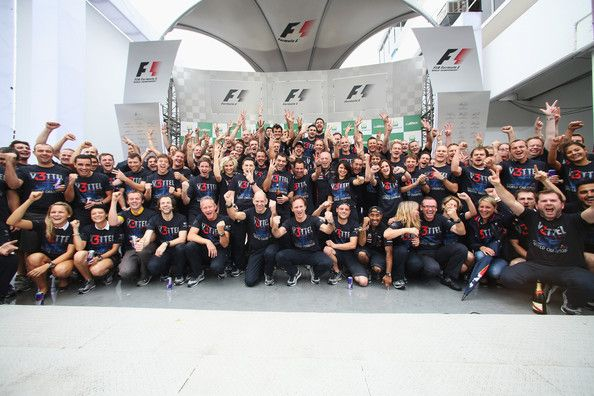 Sebastian Vettel of Germany and Red Bull Racing celebrates with team mates on the podium as he finishes in sixth position and clinches the drivers world championship during the Brazilian Formula One Grand Prix