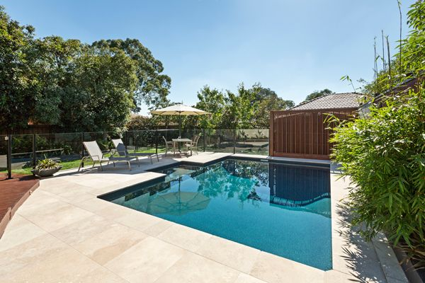 Measuring 6.0m x 4.0m, this small rectangle pool features a swim out complete with spa jets and a comfort seat. Showcasing the Antique Aqualux pool interior and surrounded by Travertine Tiles, the Blackburn South pool was built by Albatross Pools.