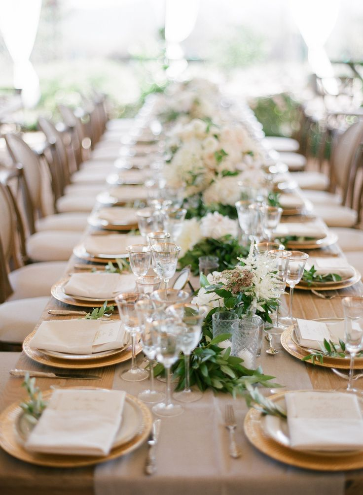 Details! Garland running the length of the table, gold-rimmed stemware, gold…