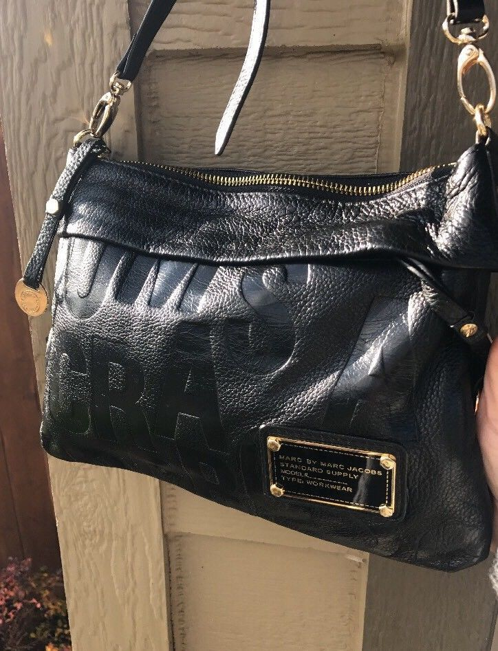 671e6f77107b Marc Jacobs Standard Supply Black Embossed Leather Logo Convertible Cross  body