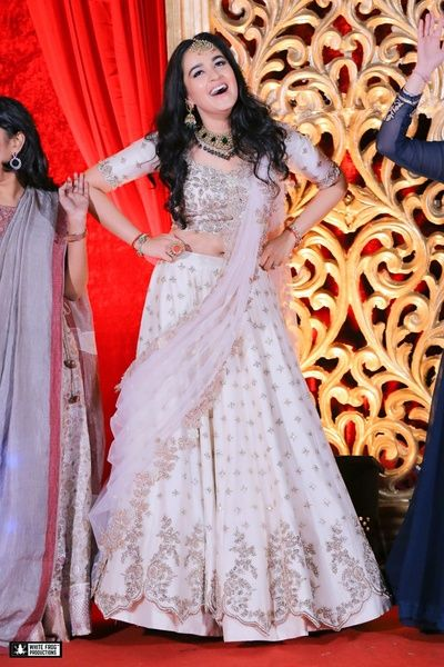 Light Lehenga - Bride in an White and Silver Lehenga | WedMeGood  #wedmegood #indianbride #Indianwedding #bridal #white #lehenga #lightlehenga #silver