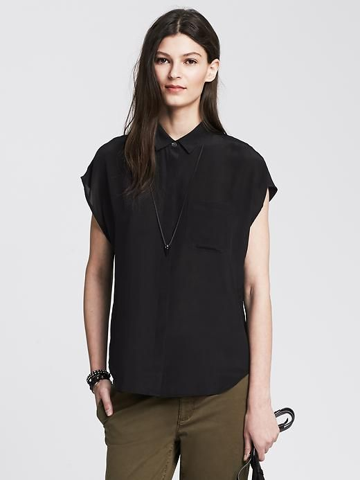 Black Silk Pocket Blouse. Sleeves are a little wonky, but it's on sale for a third of the original price!