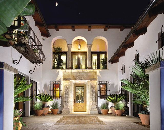 wrought iron balusters Exterior Mediterranean with balcony courtyard exterior stone