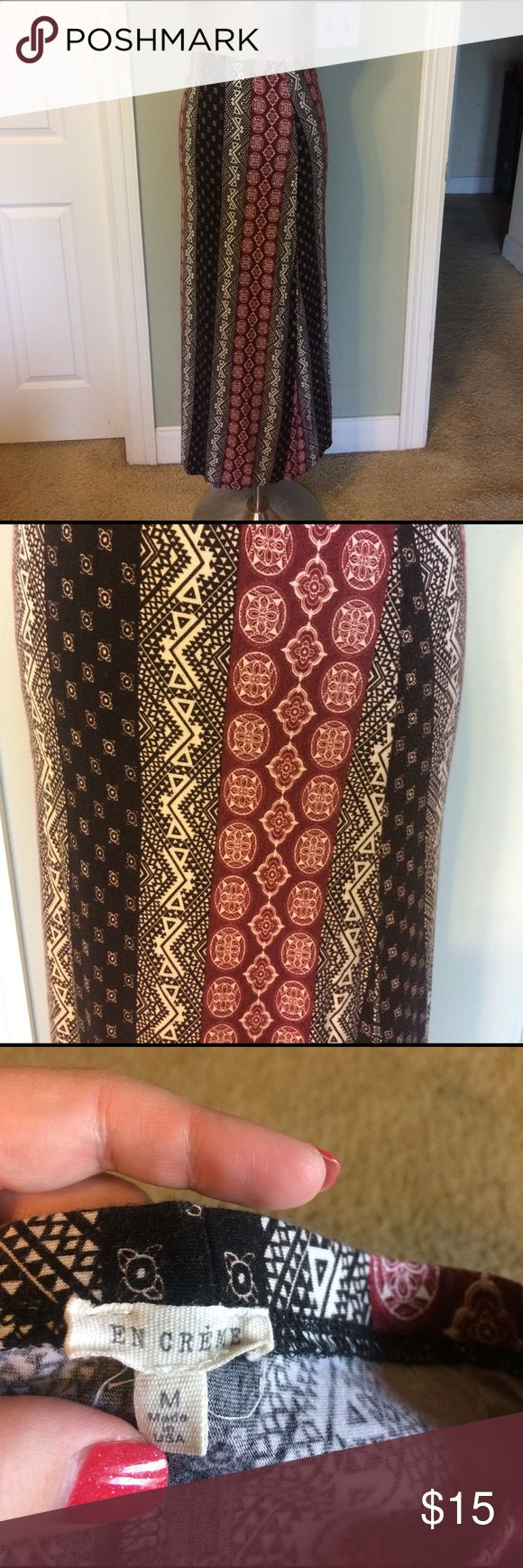 En Creme black, creme & burgundy maxi skirt med Worn twice En Creme maxi skirt in a medium. Burgundy, Creme and black printed. En Creme Skirts Maxi