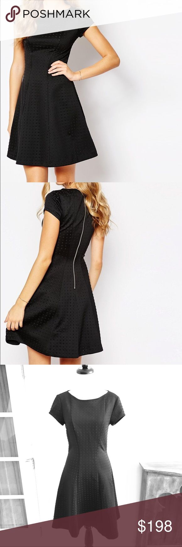 """Ted Baker- Rizzzo Black Panelled Skater Dress NWT Stunning and beautiful! Ted Baker """"Rizzzo"""" panelled skater dress in black. Short cap sleeves. Embossed fabric. Ted Baker size 2 (US size 6). Length 37.5"""". Waist 27.5"""". Roomy hip area. Brand new with tags attached. No trades please! Ted Baker Dresses Midi"""