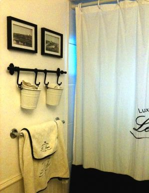French theme bathroom. Ikea buckets for face clothes. Long picture of old Paris.