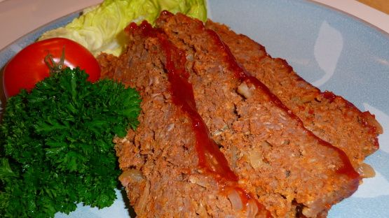 Easy, tasty meatloaf using the microwave to keep it moist. No hard crust or burnt sauce. It is a staple in our home.