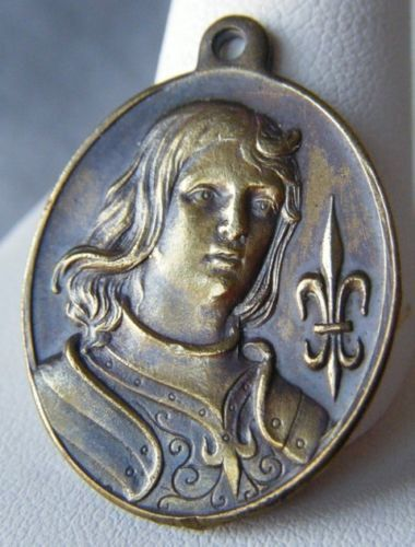 1909 Brass pendant of Saint Joan of Arc with her with her sword and shield on the back signed Nee A. very Rare a must for Collectors