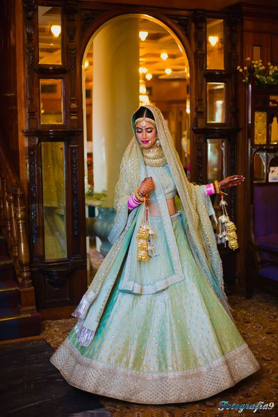 Sangeet Lehengas - Blue and Soft Pink Lehenga   WedMeGood   Twirling Bride in a Aqua Blue Lehenga with a Net Dupatta #wedmegood #indianbride #lehenga #bridal #twirling #aquamarine #pink
