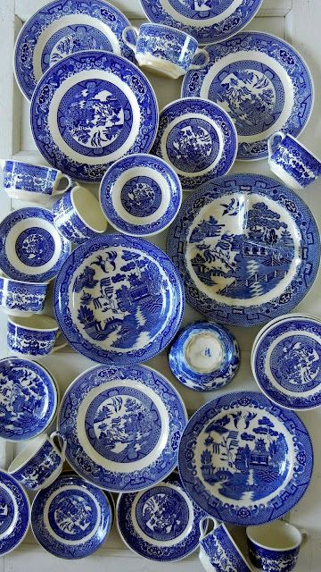 Blue Willow. I remember these dishes from my best friends house.... Having a little too much fun  she broke a couple and learned just how expensive they are