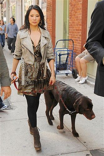 Lucy Liu looks to be deep in thought while walking her dog during filming of 'Cashmere Mafia' in New York.