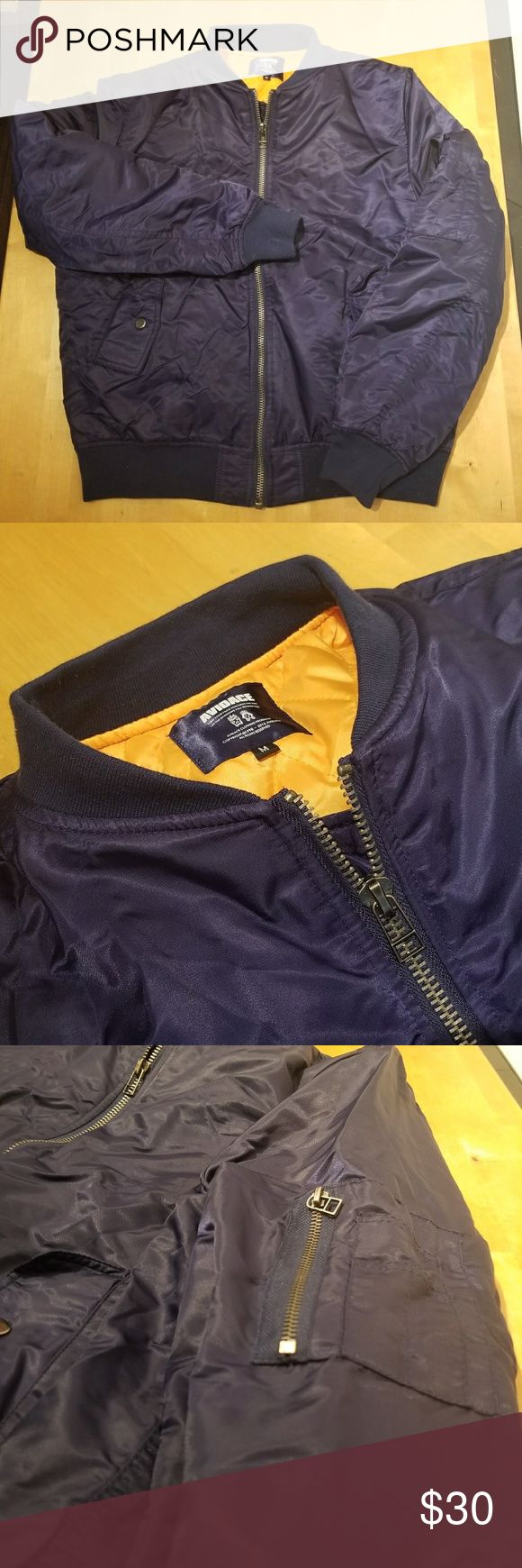 Men's nylon bomber Men's Avidace nylon bomber jacket. Dark blue with orange lining. Two snap closed hand pockets and zip pocket on arm. Like new condition, no flaws.  Men's M Chest measured 21 in flat Length shoulder to hem 25.5 in Jackets & Coats Bomber & Varsity