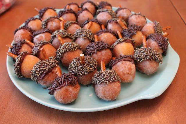 """""""Acorn"""" Donut Holes - Fast, easy and oh-so-cute for fall celebrations! Dip donut holes in Nutella or melted chocolate then dip same end in chocolate sprinkles. Insert pretzel piece for the 'stem'."""