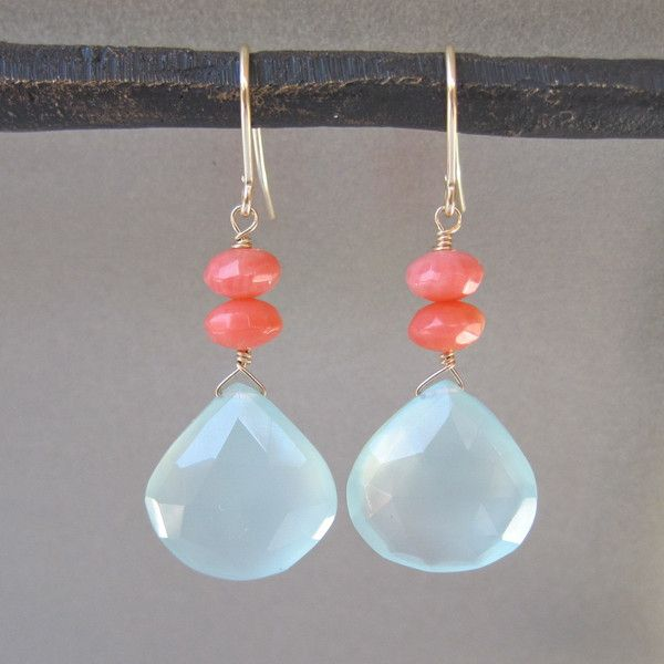 The combination of aqua and coral really make this a fun piece. These dangle earrings have aqua chalcedony briolettes with coral accents and gold hardware. These earrings are great for summer, providi