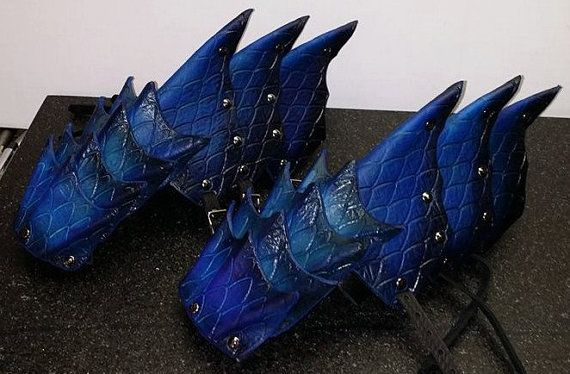 Dragon Scale Leather Gauntlets  *Hand crafted  *Custom made using your measurements  *10oz Premium Leather  *Strap & buckle closure *Made in your choice of color(s). We can mix almost any color you like.  *We will contact you after you order to request your measurments.  All custom items are made after receiving your paid order, measurements, and color choice. Construction time may vary depending on the number of orders currently in our construction queue. Please feel free to contact me…