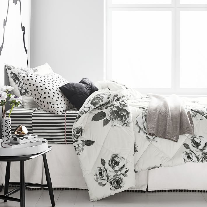 The Emily & Meritt Bed of Roses Comforter + Sham. Add a touch of glamour to your sleep space with our comforter and sham set featuring a chic floral pattern that you'll love. This comforter and sham are designed exclusively for PBteen by celebrity stylists and fashion designers Emily Current and Meritt Elliott.