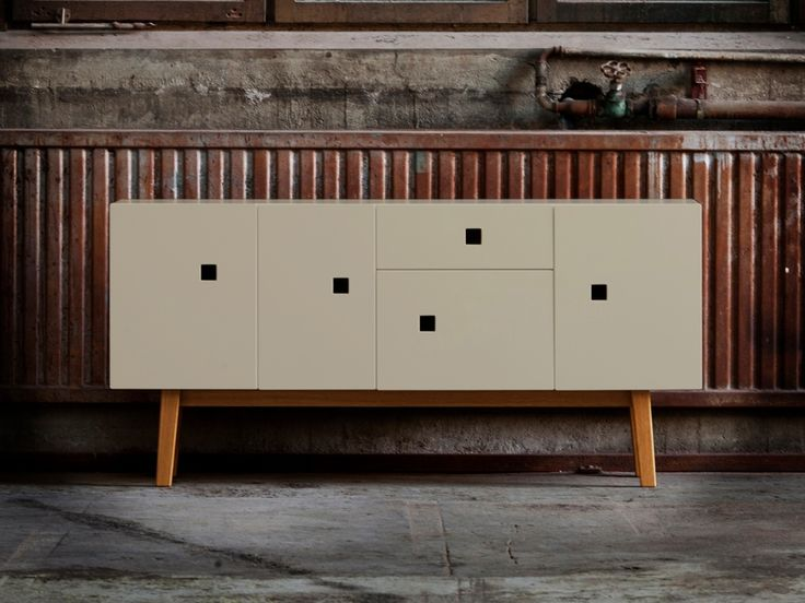 The Peep C3 Credenza (in soft sand) features four doors and one drawer, stands 57″ wide x 27″ tall x 13.5″ deep with bases made of Ash or Oak