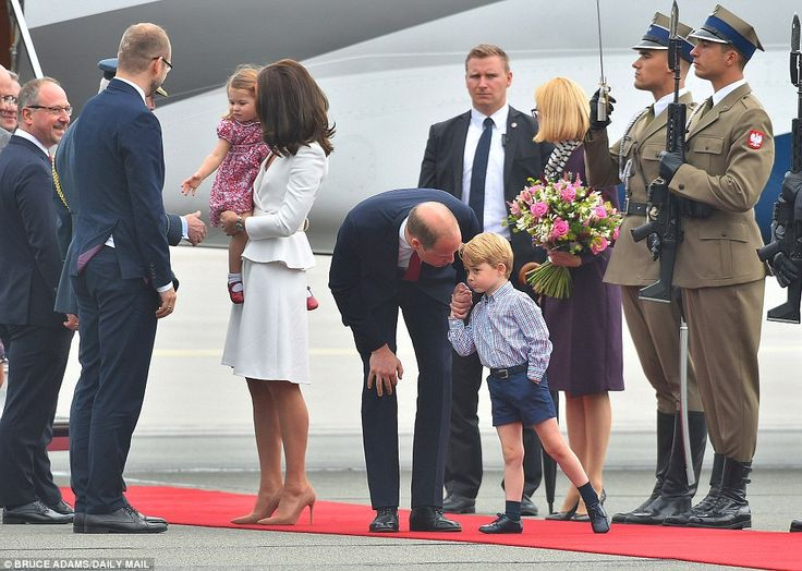 She's a natural! Charming Prince Charlotte needed no encouragement to shake hands in the line-up, but her brother wasn't so sure