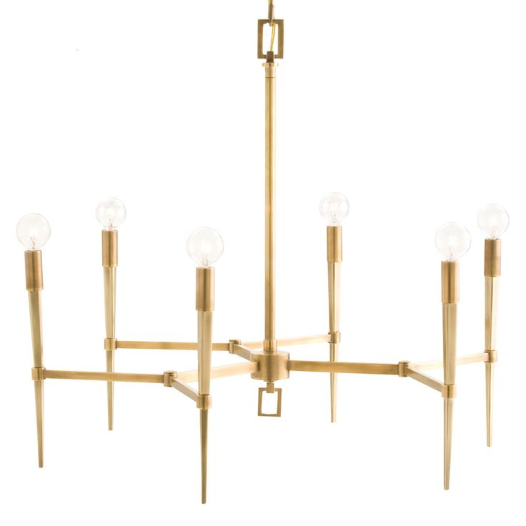 Thoughtfully simple with a sleek silhouette, the Auburn chandelier in antique brass brings mid-century modern charm to sophisticated living rooms or entry ways. Tapered arms meet exposed globe bulbs on this geometrically-inspired hanging light fixture by Arteriors.