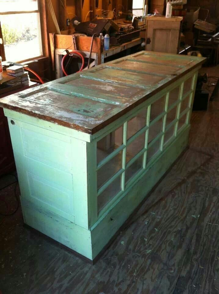 Kitchen island made from old doors and Windows.--We could used that glass door that we have saved in the ahed!!