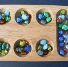 Mancala is a lovely African game.  We play all summer long!