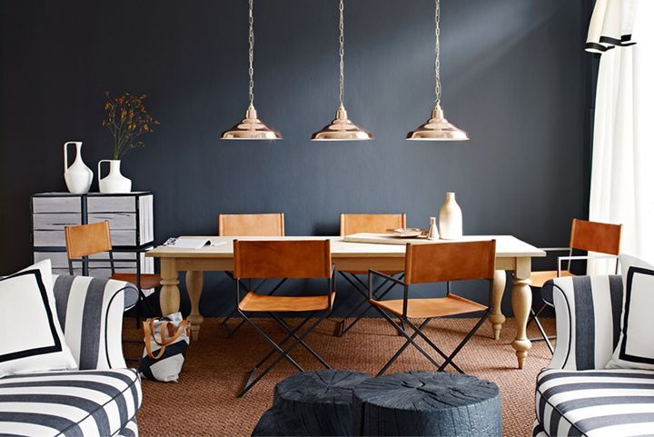 Love the gray walls and striped sofas! And the lighting fixtures!