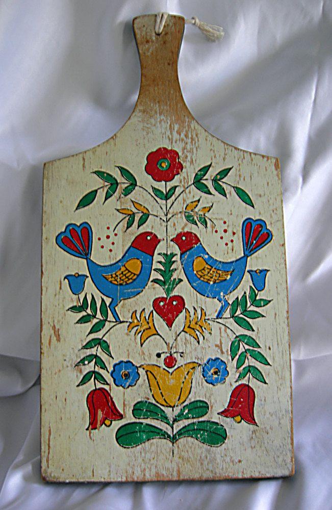 Shabby Worn Cottage Chic Amish Pennsylvania Dutch Hex Distlefink Design Bread and Cutting Board - Vintage 1950 - 1970. $17.00, via Etsy.