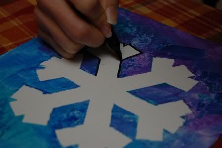 Art So Easy, A Toddler Can Do It.  Masking tape to make snowflake design on canvas.  Kids paint over it with shades of blue/purple paint.