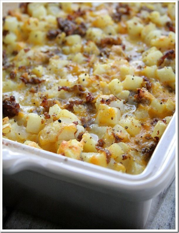 Cheesy Potato Breakfast Casserole serves 12-15     1 pound Johnsonville Mild Italian Sausage, cooked     1 yellow onion, chopped, sauteed in sausage grease     7 eggs     1/2 cup milk     20 ounce bag frozen Ore-Ida Diced Hash Browns     8 ounce brick of Mild Cheddar Cheese, grated     Salt & Pepper, to taste