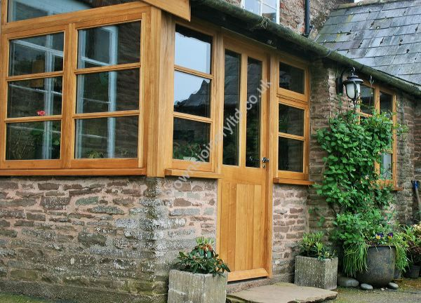 New Oak timber entrance porch with windows and doors to stone cottage by www.brownsjoineryltd.co.uk