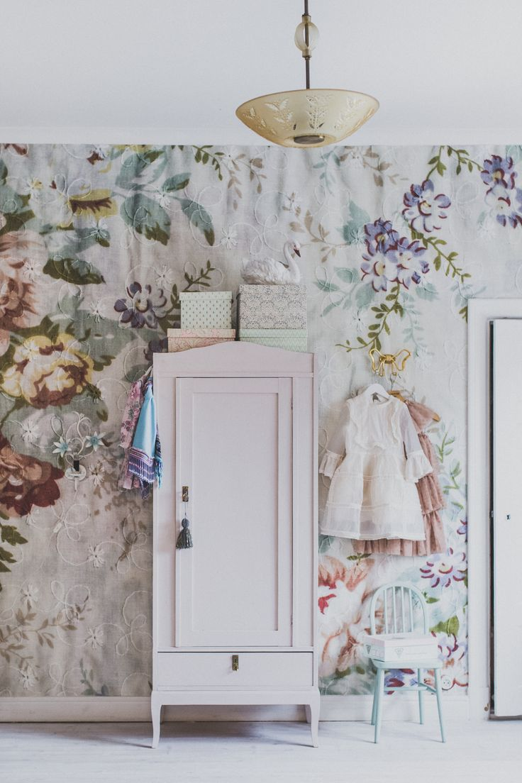 Floral wallpaper and painted furniture
