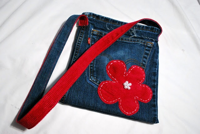 This tutorial for turning jeans into a small bag could work for baby girl's Christmas Elmo bag