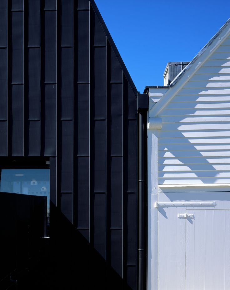 A pointy black entrance building has been added to the historic dockyards of Chatham, England, as part of a major expansion of the local nautical museum – one of six projects in the running for this year's Stirling Prize.