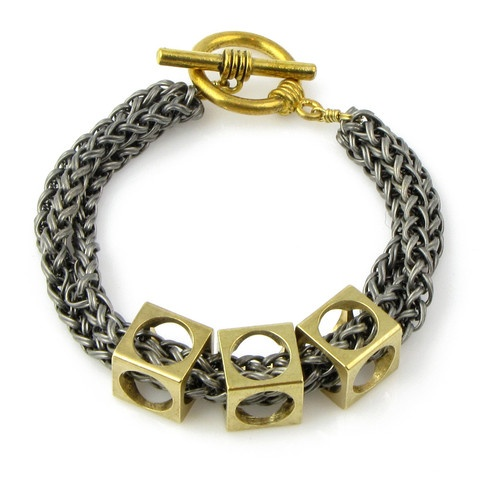 http://metanajewelry.com/collections/frontpage/products/circle-square-modern-cube-bracelet-large