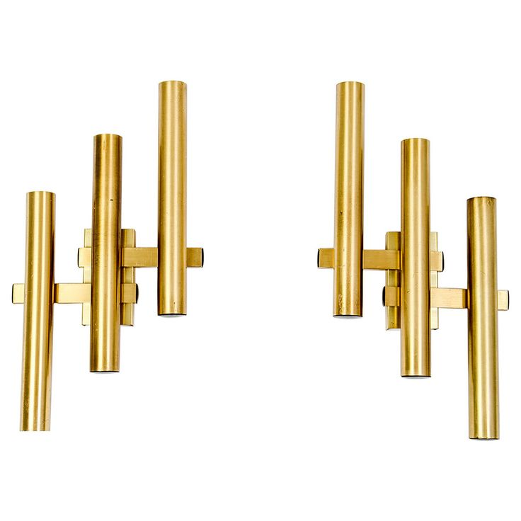 Pair of Geometric Midcentury Wall Sconces on Golden Aluminium | From a unique collection of antique and modern wall lights and sconces at https://www.1stdibs.com/furniture/lighting/sconces-wall-lights/