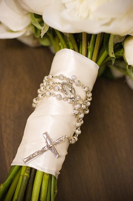 Bouquet wrapped with rosary